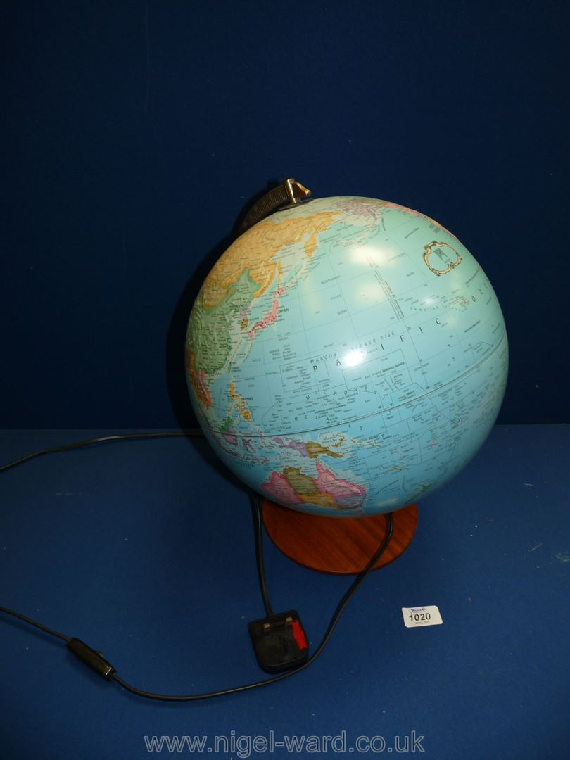 An illuminated 'The Political world' globe by Micador with raised mountain ranges.