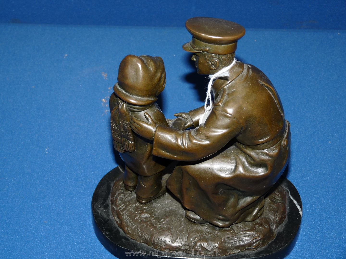 A Bronze figure of a soldier helping a young child, on marble plinth, 'H. - Image 5 of 5
