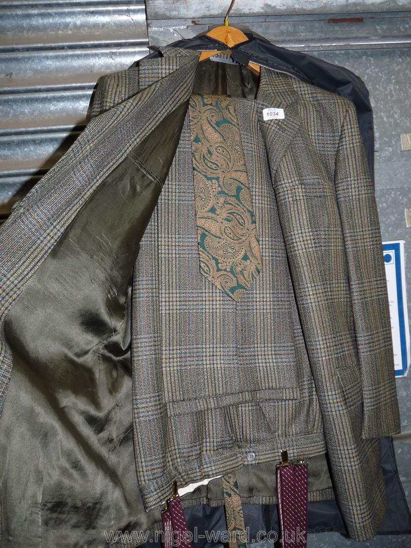 A gents tweed made to measure suit consisting of a button up jacket and trousers with braces, - Image 2 of 2