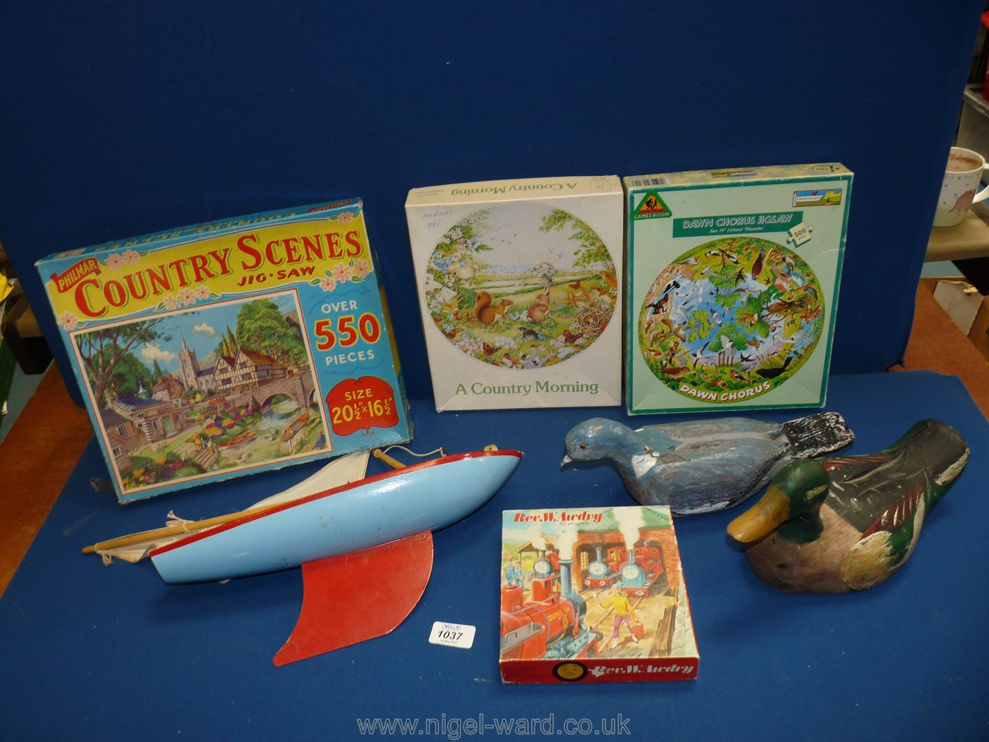 A vintage sailing boat, painted duck, selection of puzzles and a mid 20th c.