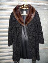 A faux fur lamb cut Coat, size 12, three quarter length.