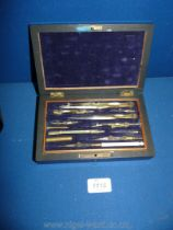 A Rosewood cased box of vintage brass and ivory draughtsman's Drawing Instruments with protractors,