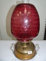 A Victorian Church oil/heater Lamp with squat brass base, having central draught,