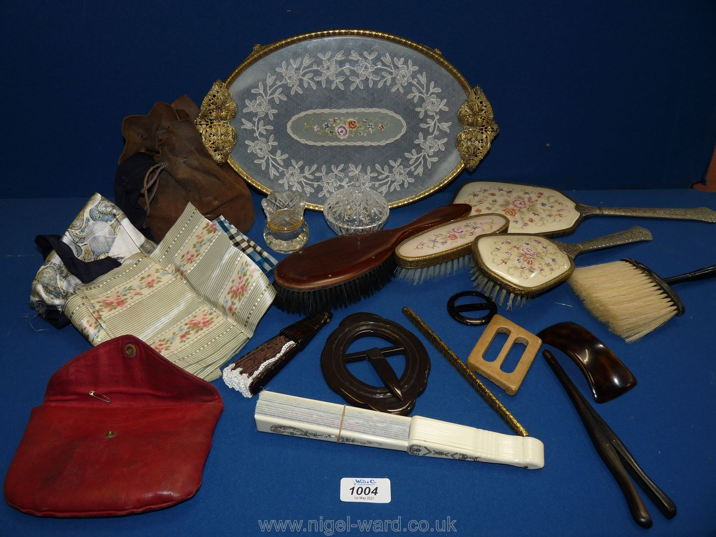 A quantity of miscellanea including dressing table set, fans, little leather pouch of silk scarves,