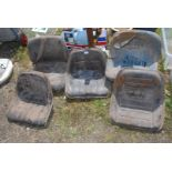 Five various tractor Seats.