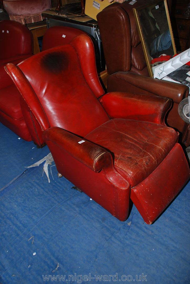 A leather effect wingback reclining chair.