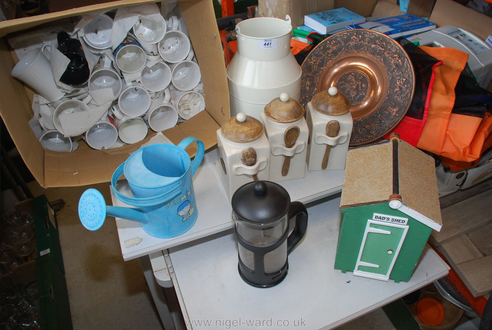 A box of various mugs, kitchen storage boxes and shopping baskets, etc.