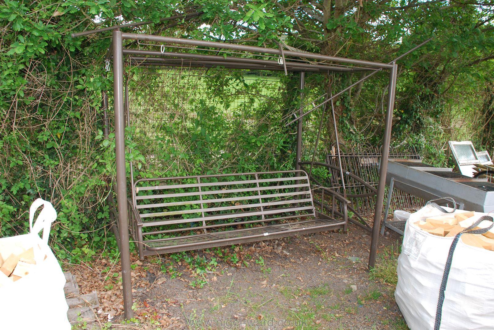 A three seat metal garden Swing seat, a/f (lacking cushions).