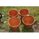 Four terracotta flower pots, (one a/f).