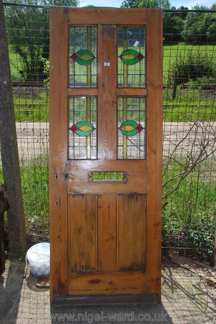 A part glazed front Door, 29 3/4'' wide x 77'' high x 1 3/4'' deep.