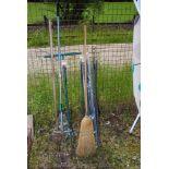 A set of nylon drainage rods, garden tools, etc.