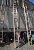 A sixteen rung single extension wooden Ladder.