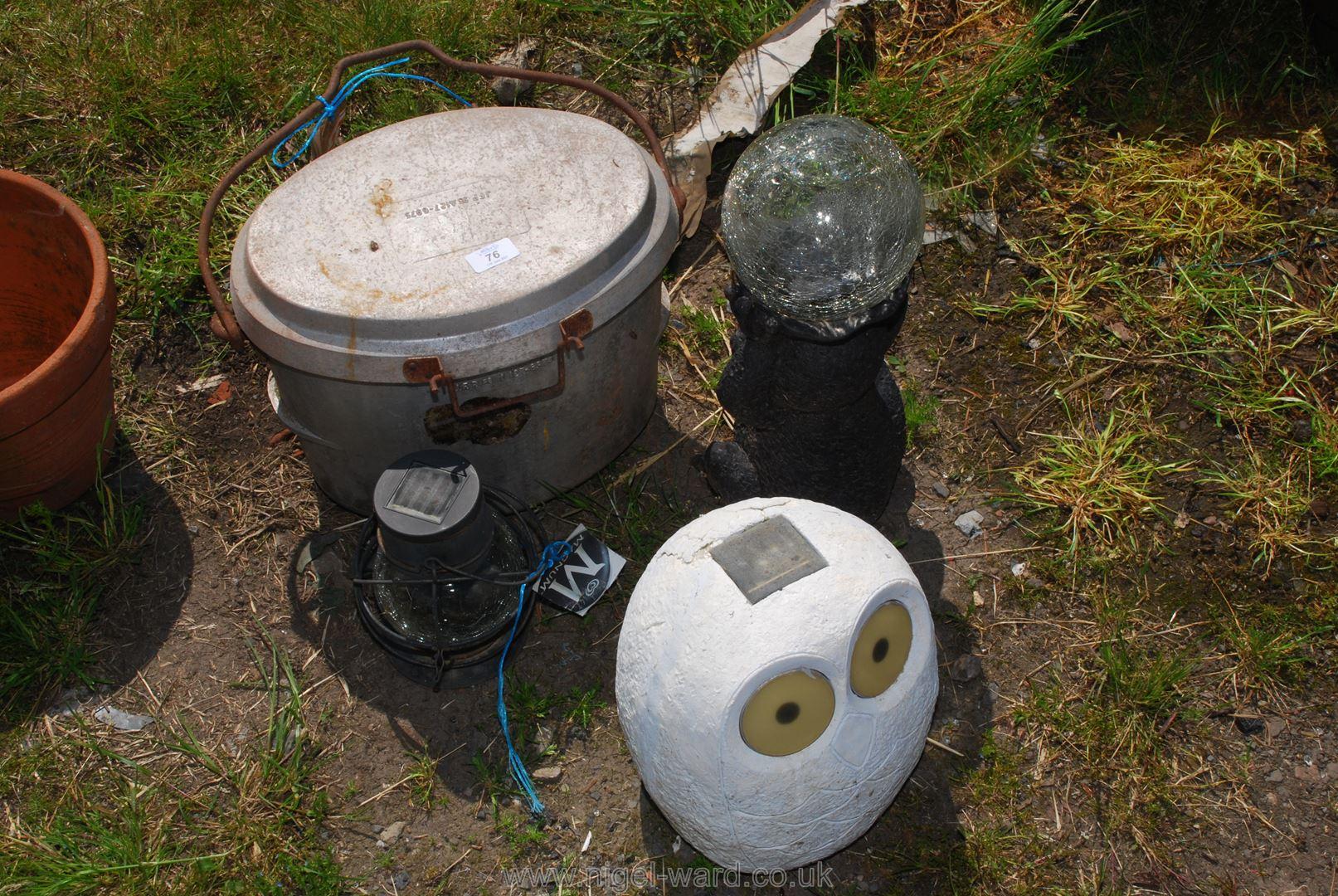 A lidded swing pot and three garden solar lights.