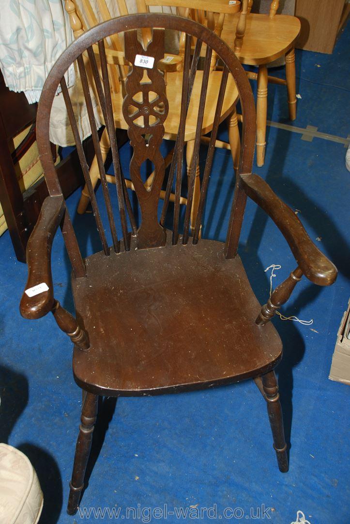 A wheelback carver chair.