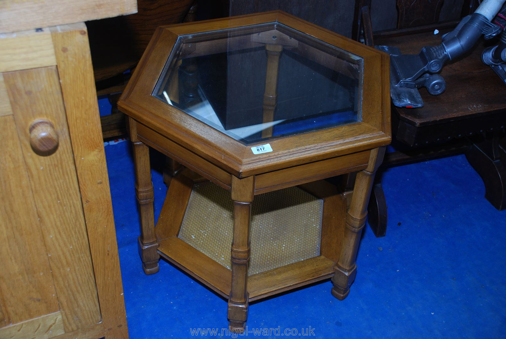 A hexagonal glass top occasional table.