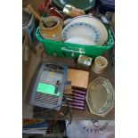 A basket of various plates, lights, china, butter knives and a car battery charger.