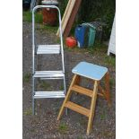 A wooden two stage kitchen steps and two step aluminium ladder.