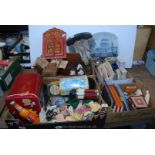 Four boxes of treen, tins, Mickey Mouse heads etc.