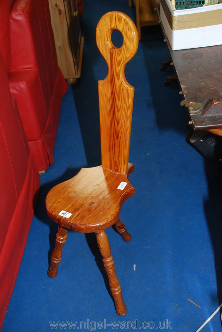 A pine spinning chair.