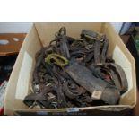 A box of horse tack, bridle etc.