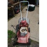A Briggs & Stratton petrol Mower on aluminium body with grass collecting box.