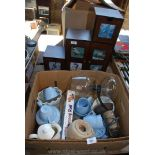A box of part teaset, jelly moulds, coffee pot and wooden shelf unit.