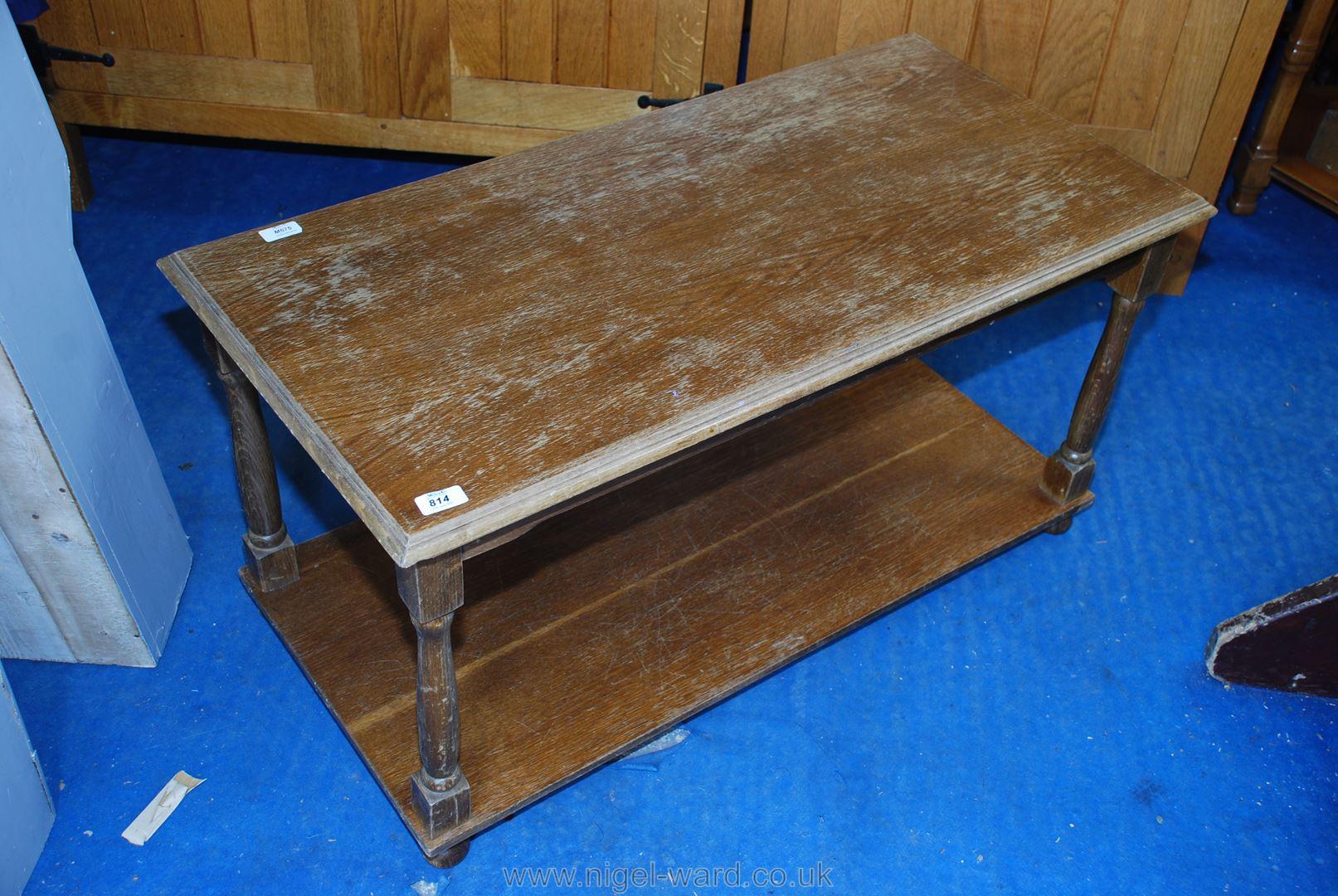 An oak coffee table with lower shelf.