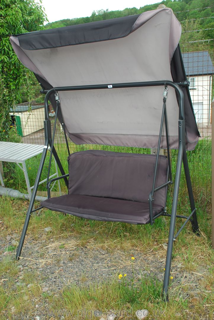 A two person garden swing seat and cover.