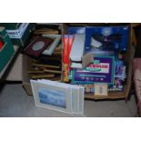 A box of miscellaneous games including 'Balderdash' and a box of picture frames.