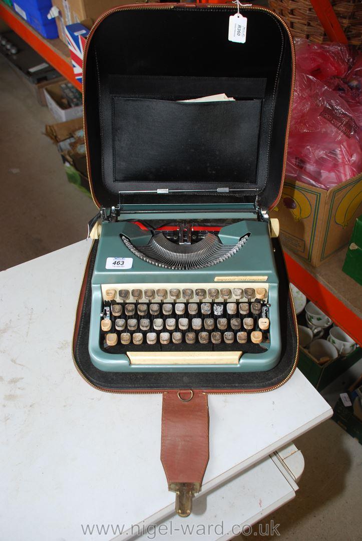 A cased portable typewriter.