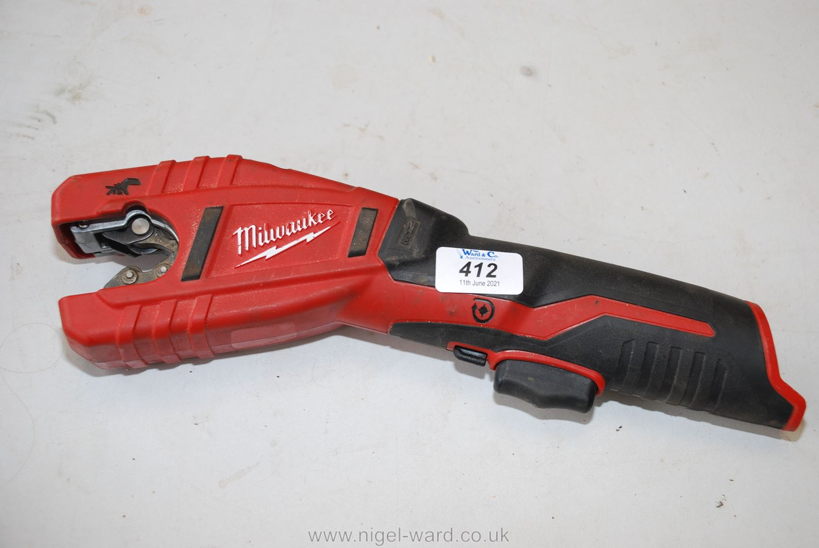 A Milwaukee battery operated pipe cutter.
