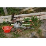 A quantity of watering cans, stilsons, ladle, tools, etc.