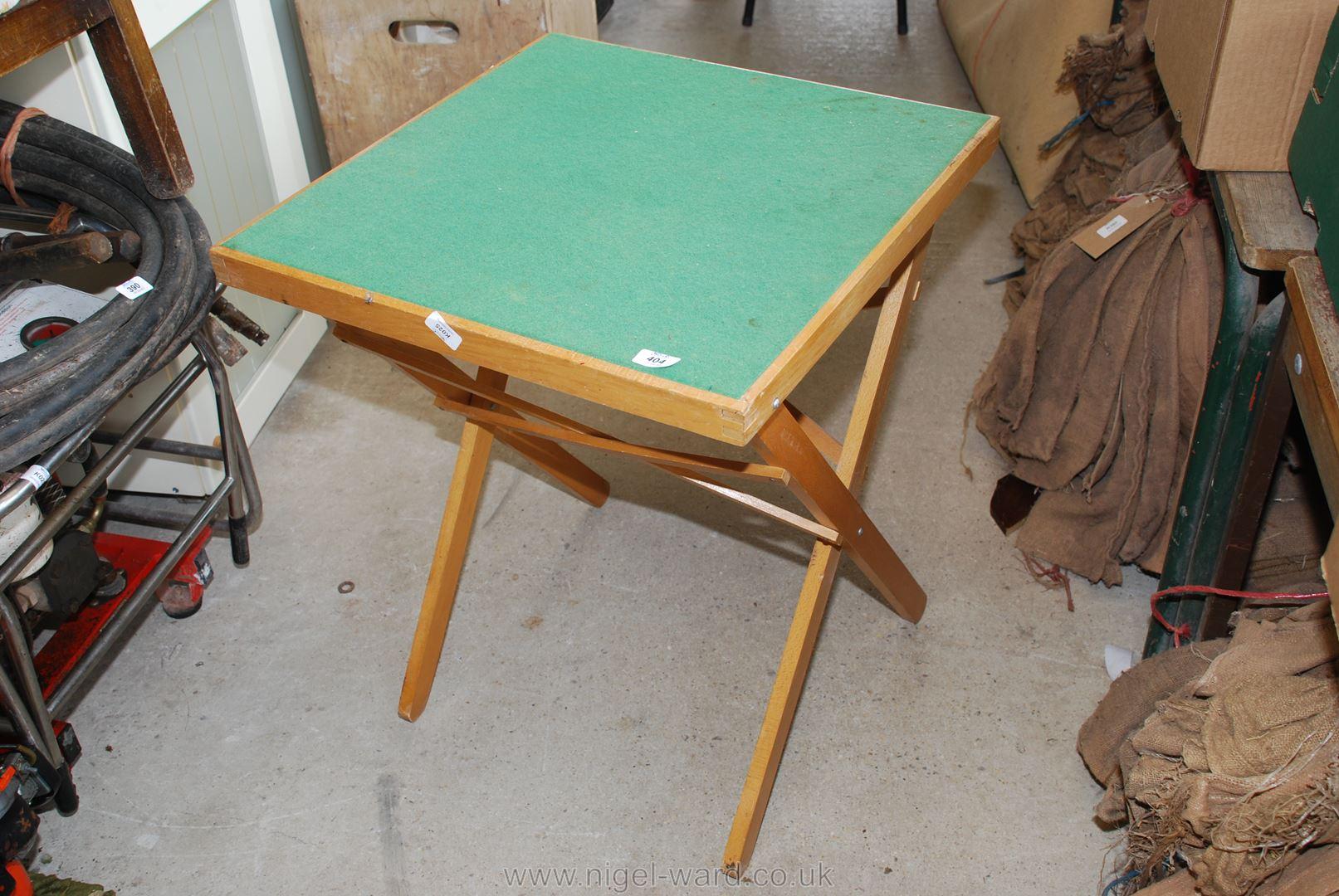 A folding Card table.
