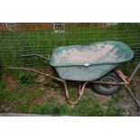 A plastic builder's Barrow with pneumatic tyre.