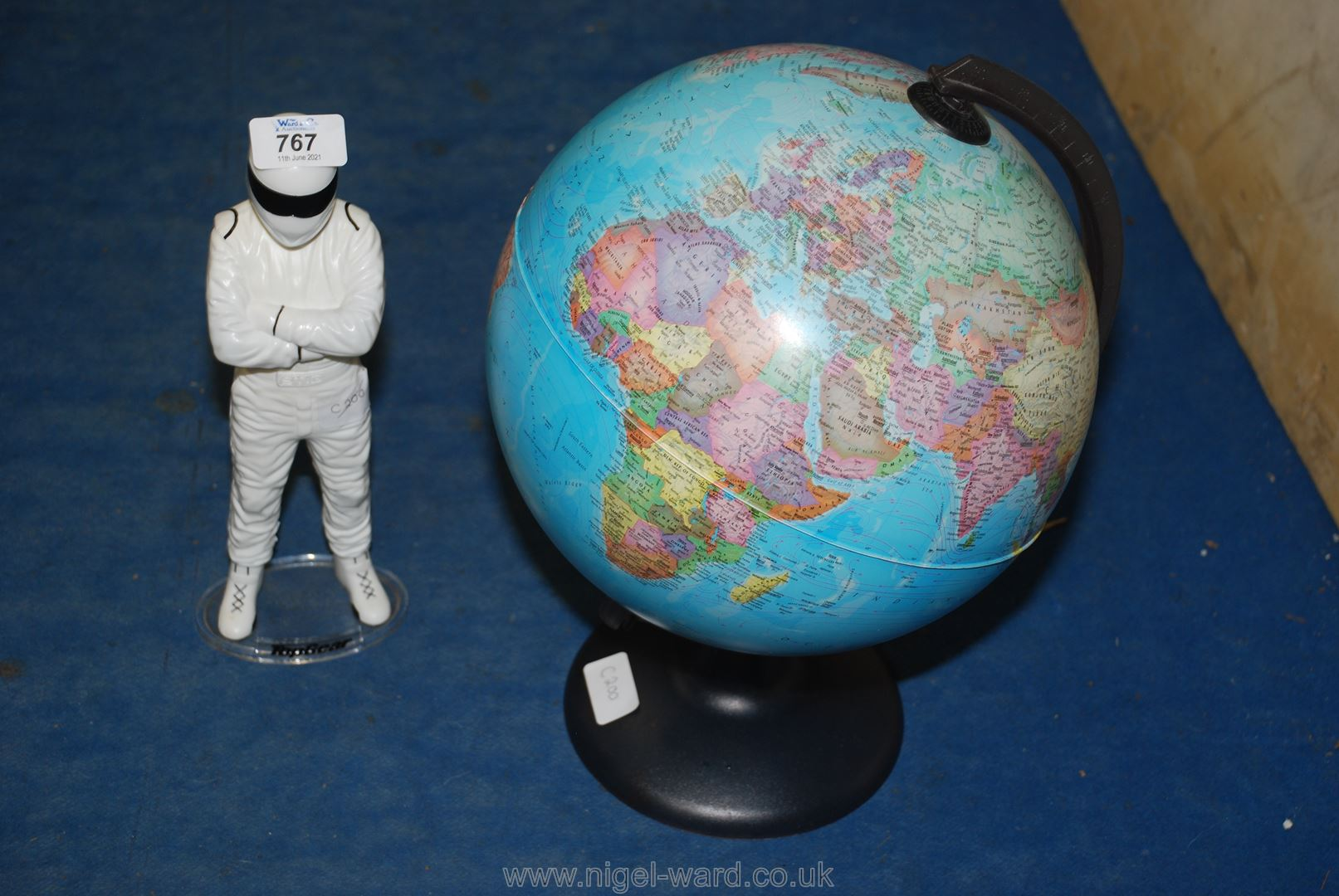 A small globe and a stig figure.