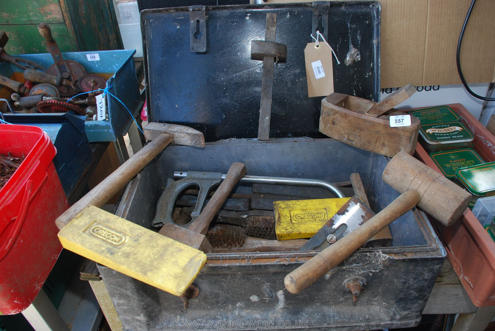 A metal box containing marking gauge, mallet, planes, tools etc.
