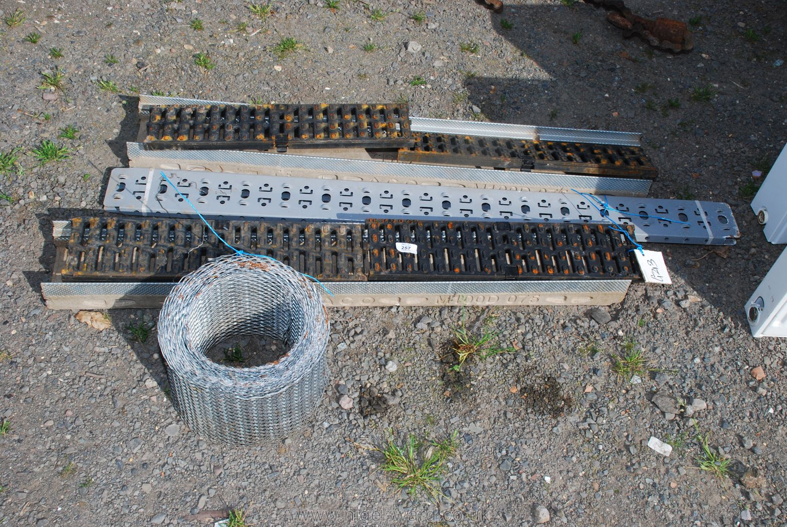 A coil of ex mesh and drainage gully's, etc.