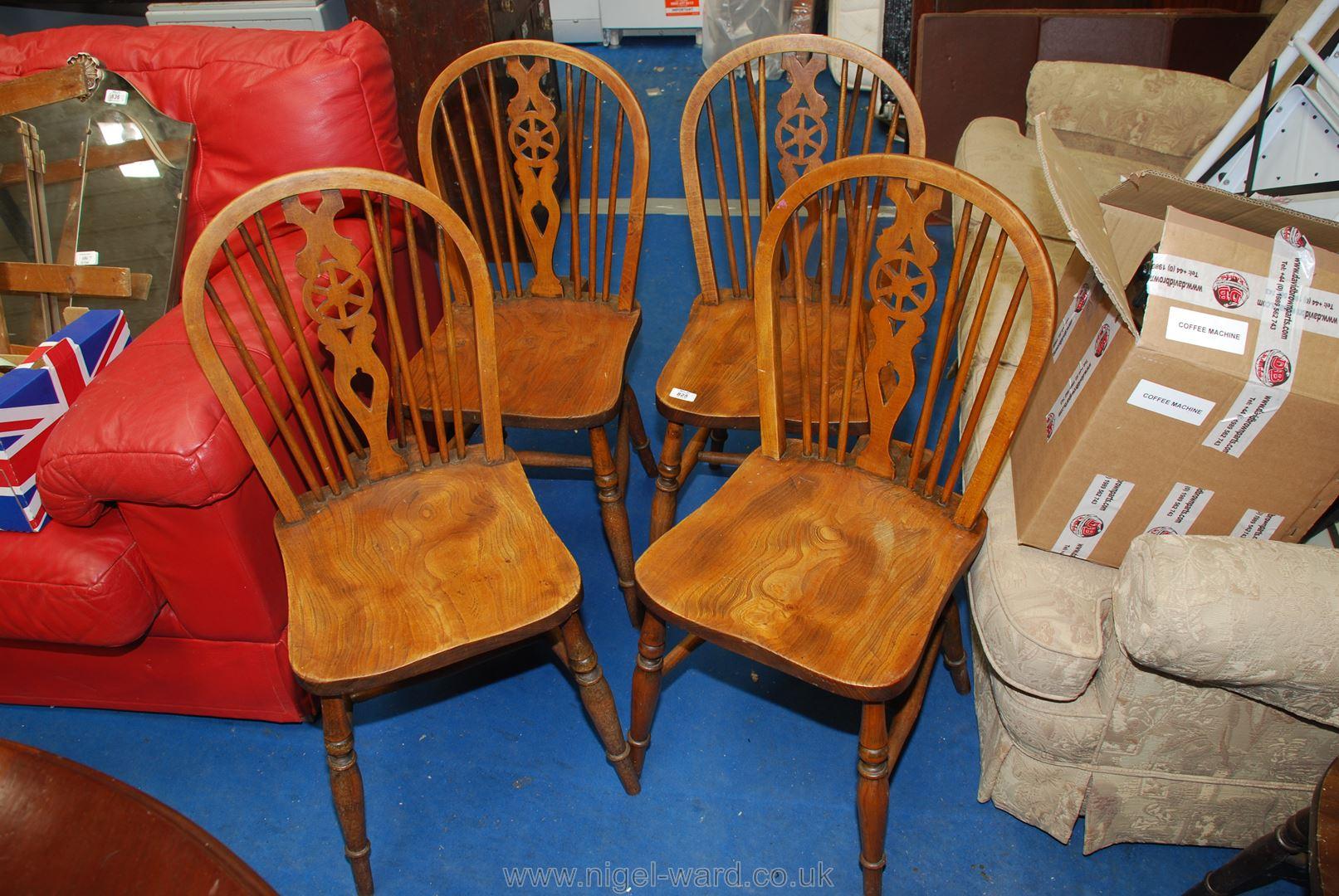 Four wheelback kitchen chairs.