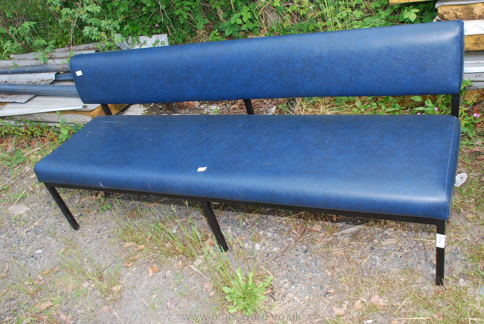 A metal framed leather effect Bench/seat, 6' long.