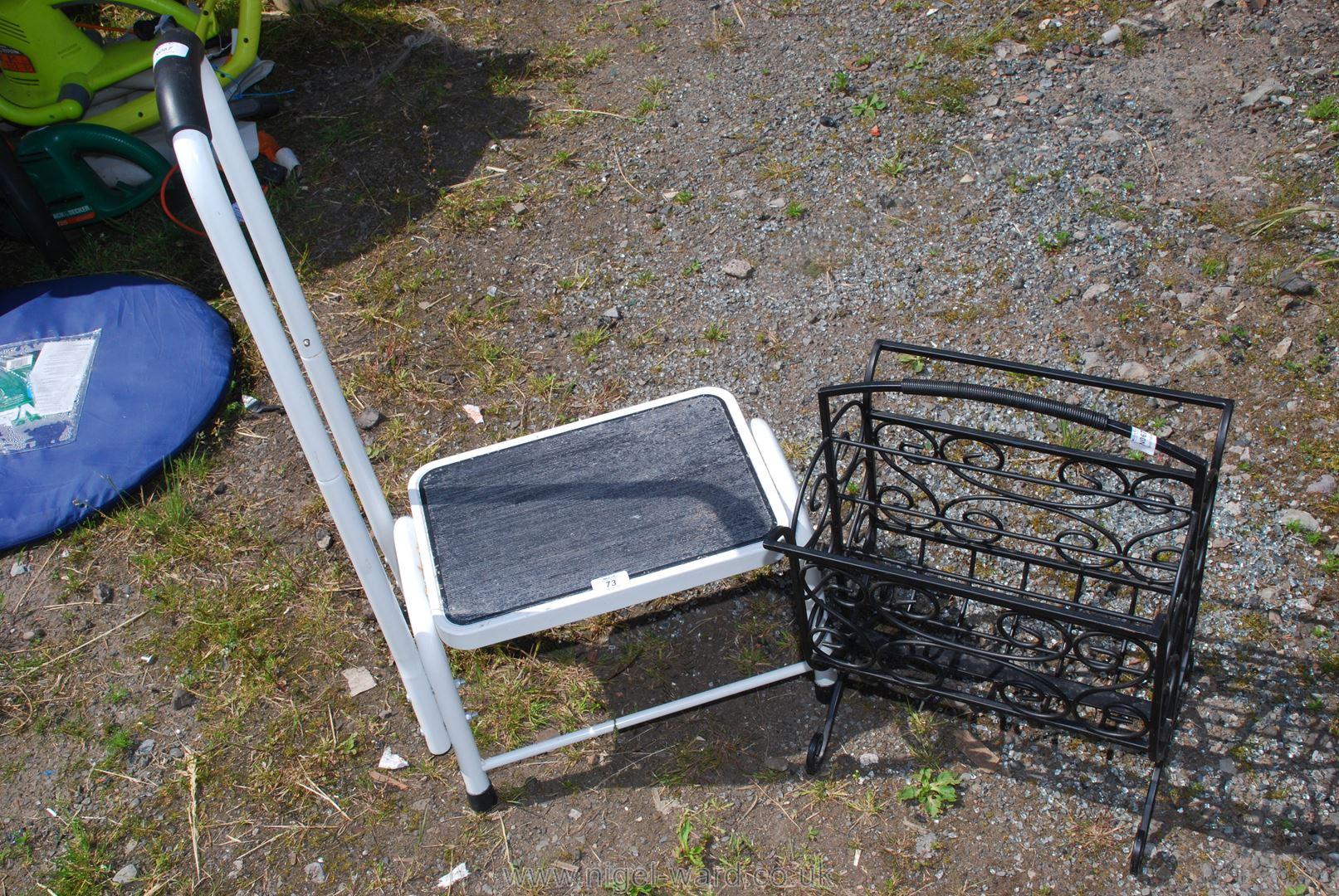 A handy stepper and a metal magazine rack.