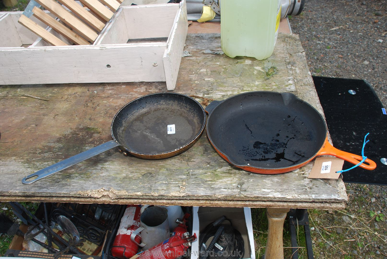 A Le Creuset frying pan and another.