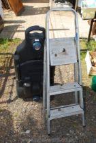 A two rung aluminium step ladder and a caravan waste hog.