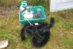 Two garden sprayers, bird feeder and a gutter hedgehog brush.