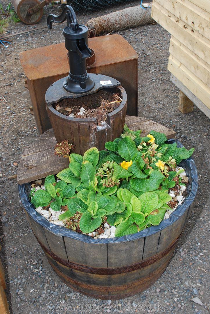A wooden 1/2 barrow garden planter with feature.