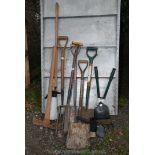 A quantity of garden forks, spades, shovels, tools, etc.