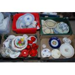 A blue and white dinner service, plus three boxes of various plates, mugs etc.