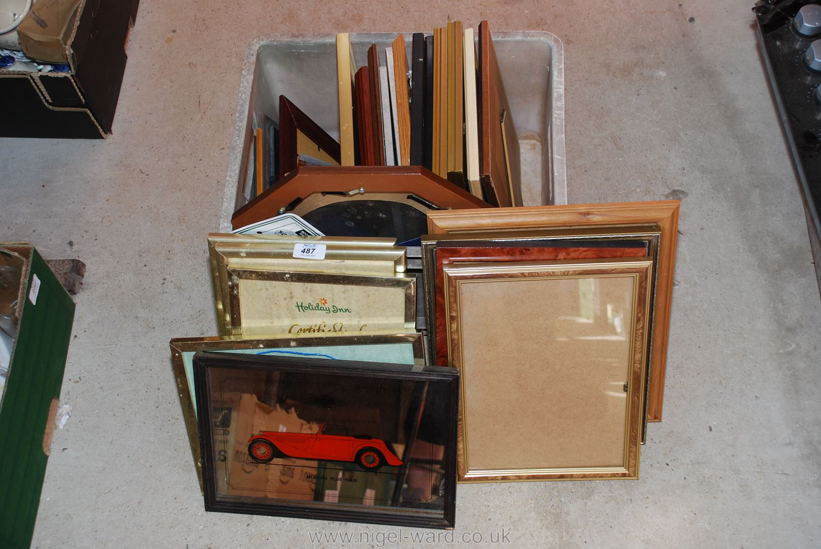 A large box of glazed picture frames, mirror etc.