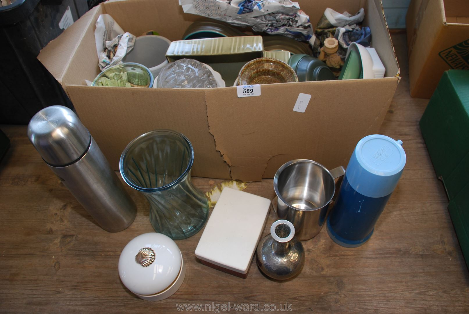 A box of flasks, vases and miscellaneous china.