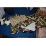 A wool blanket and a quantity of floral printed covers etc.