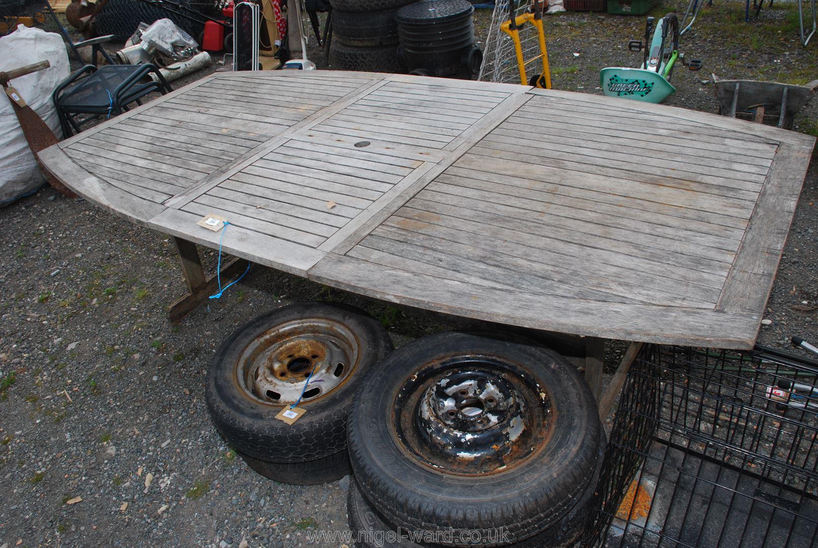 An 8ft long teak style patio table.